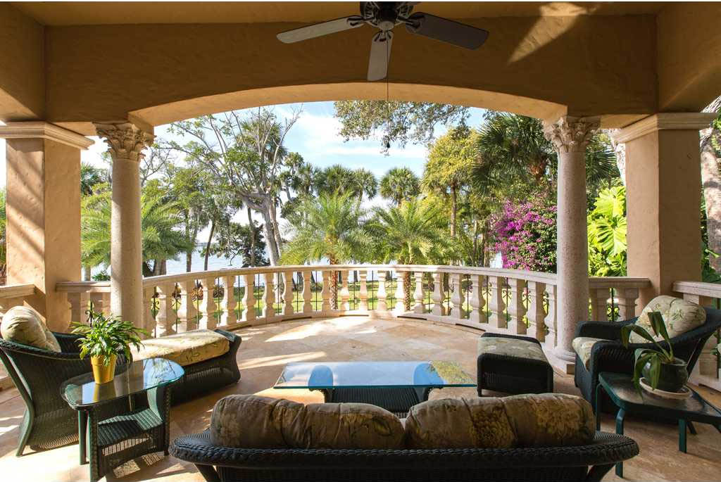 this merritt island luxury homes master suite balcony - Luxury Homes Master Bedroom